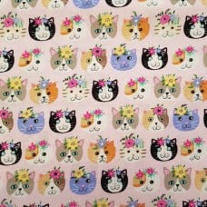 Cats Heads Cotton Fabric in Pink Fabric Traders